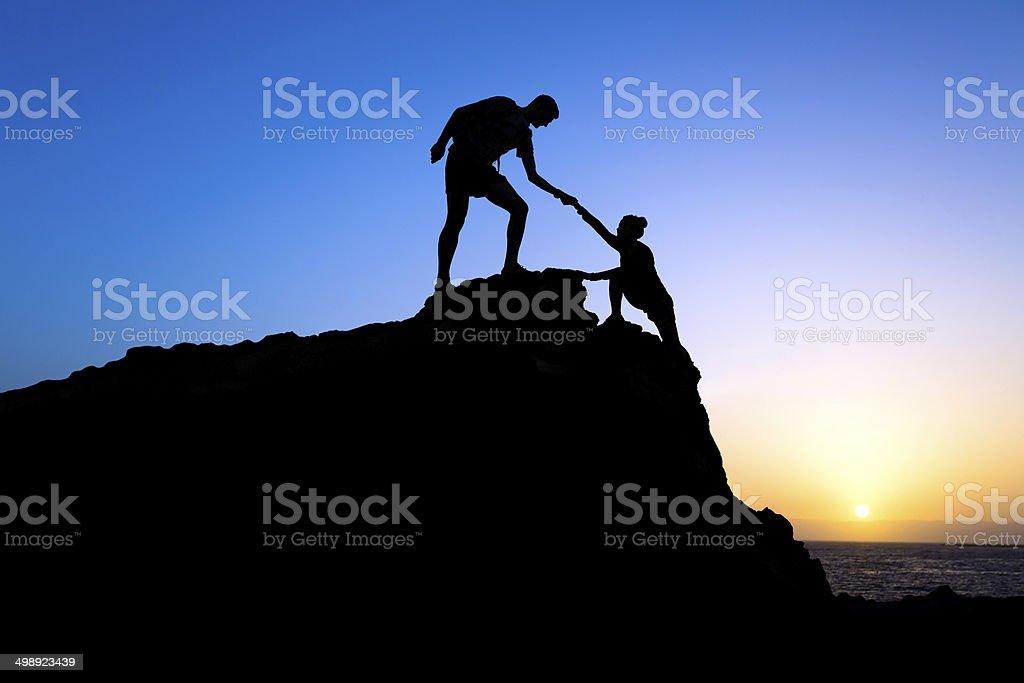 Teamwork, couple help silhouette stock photo