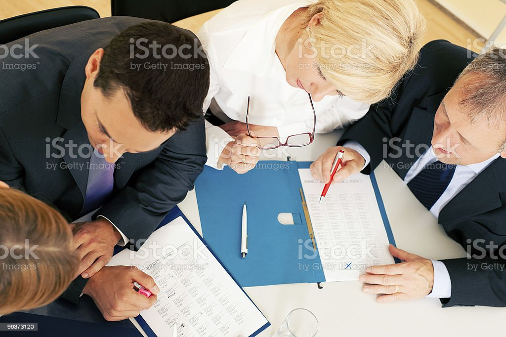 Teamwork - discussion in the office royalty-free stock photo