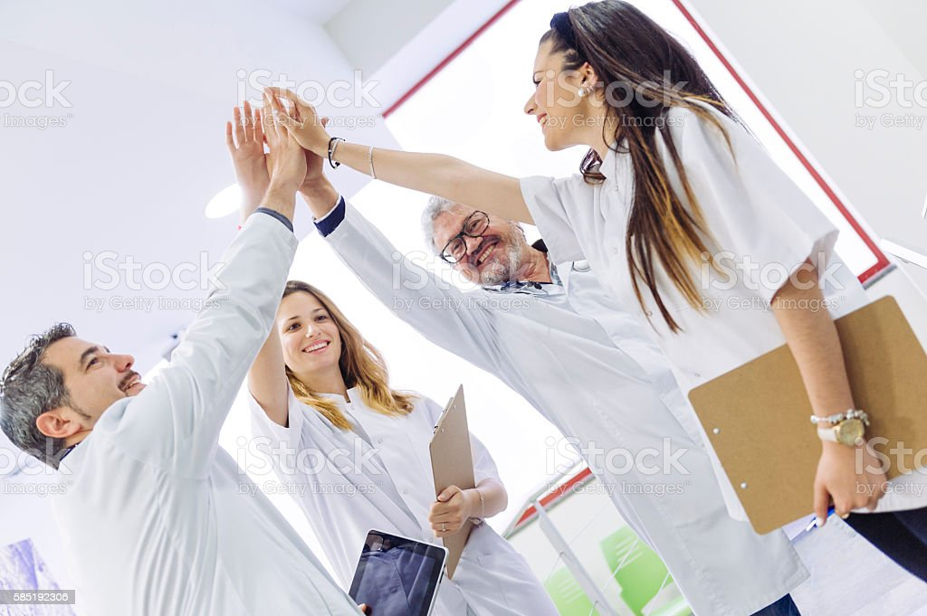 Teamwork doing high-five stock photo