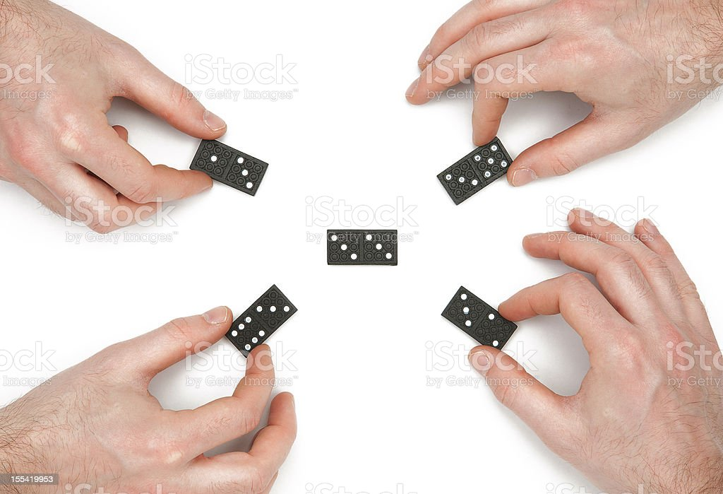 Teamwork domino concepts: adding different ideas to common project stock photo