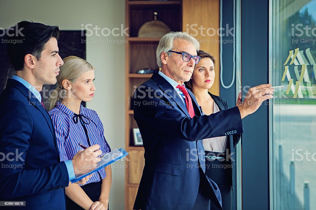 Teamwork group discussion in the CEO office stock photo