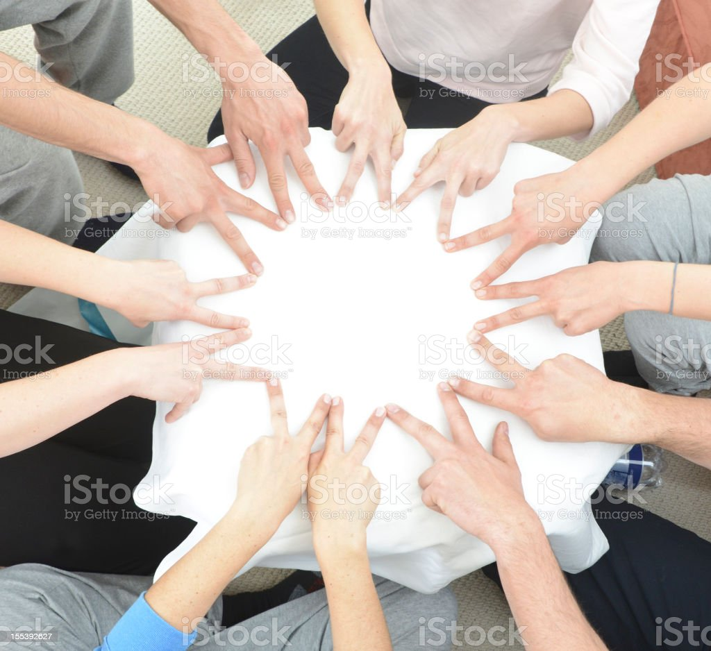 teamwork hand building star in circle with fingers - Sternförmig royalty-free stock photo