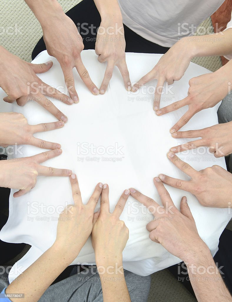 teamwork hands forming star with fingers in group stock photo