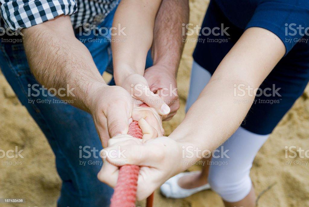 teamwork hands on rope - Hände ziehen an Tau stock photo
