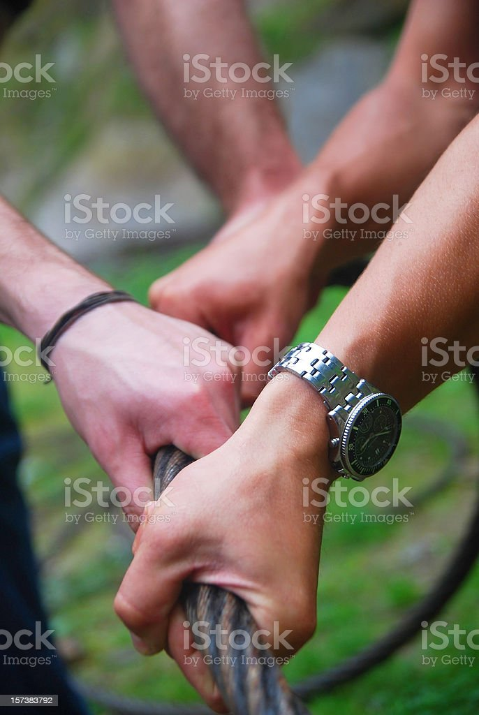 teamwork hands on rope stock photo