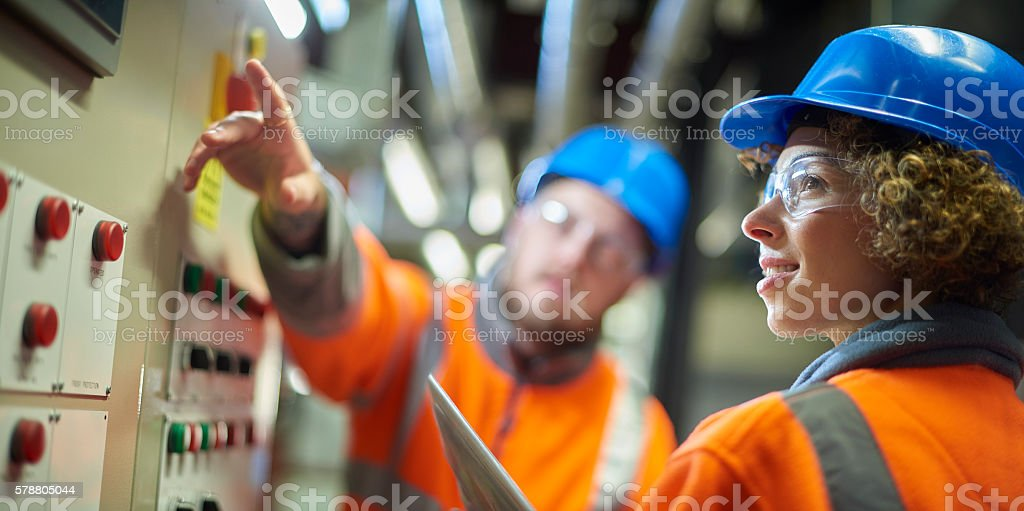teamwork in the boiler room stock photo