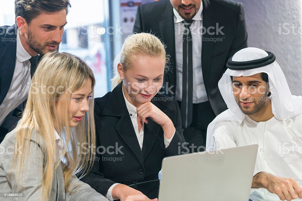 Teamwork in the Middle East stock photo
