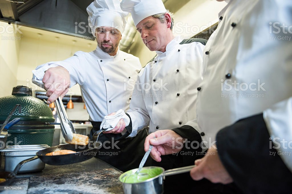 Teamwork is very important in the kitchen stock photo