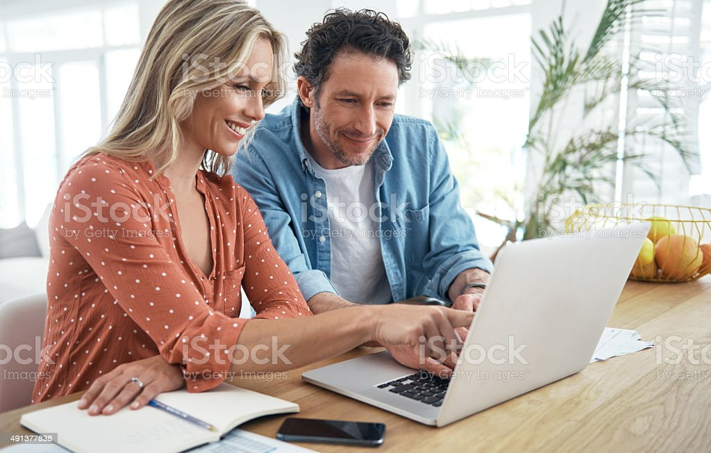 Teamwork makes budgeting better stock photo