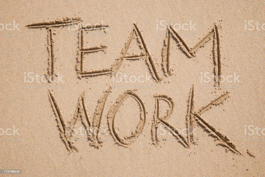 Teamwork Message Handwritten in Sand royalty-free stock photo