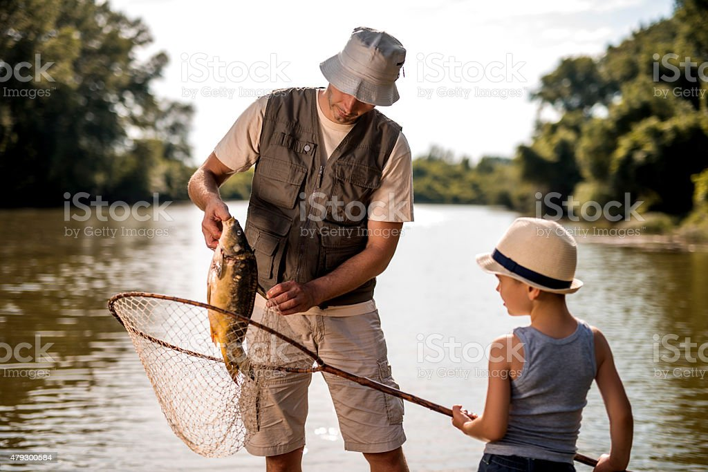 Teamwork of a water and son on fishing. stock photo
