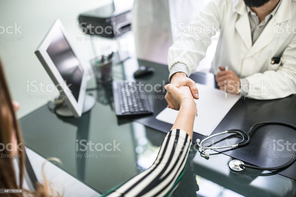 Teamwork of doctors in the office for a meeting stock photo