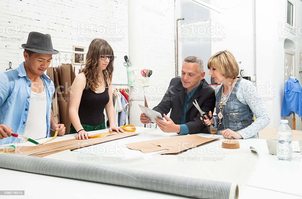 Teamwork of fashion designers stock photo