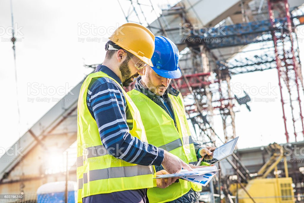 Teamwork on  construction site with main engineer and architect stock photo