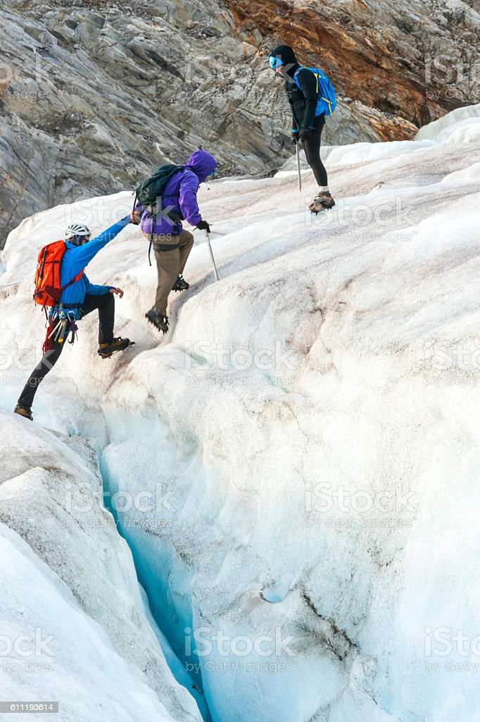 Teamwork on the icy glacier stock photo
