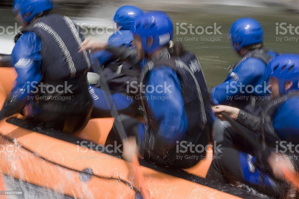 Teamwork on whitewater royalty-free stock photo