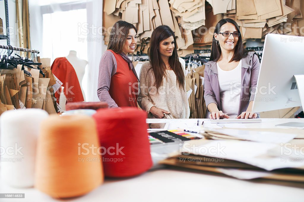 Teamwork sharing designs on a computer. stock photo