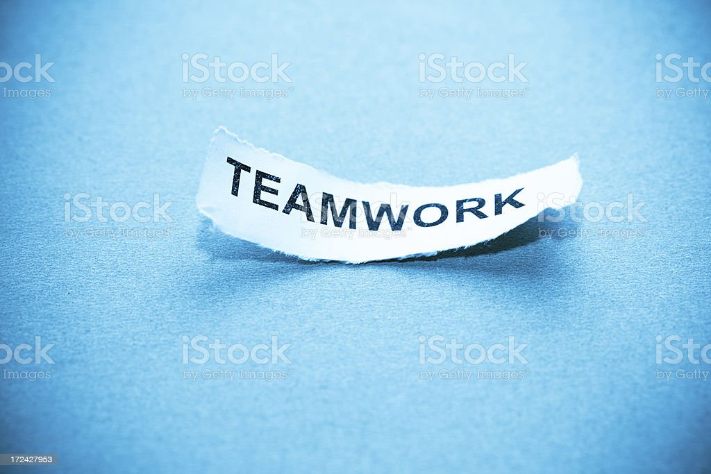 teamwork text on curved paper royalty-free stock photo