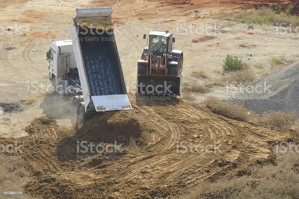 Teamwork, tractor and truck stock photo
