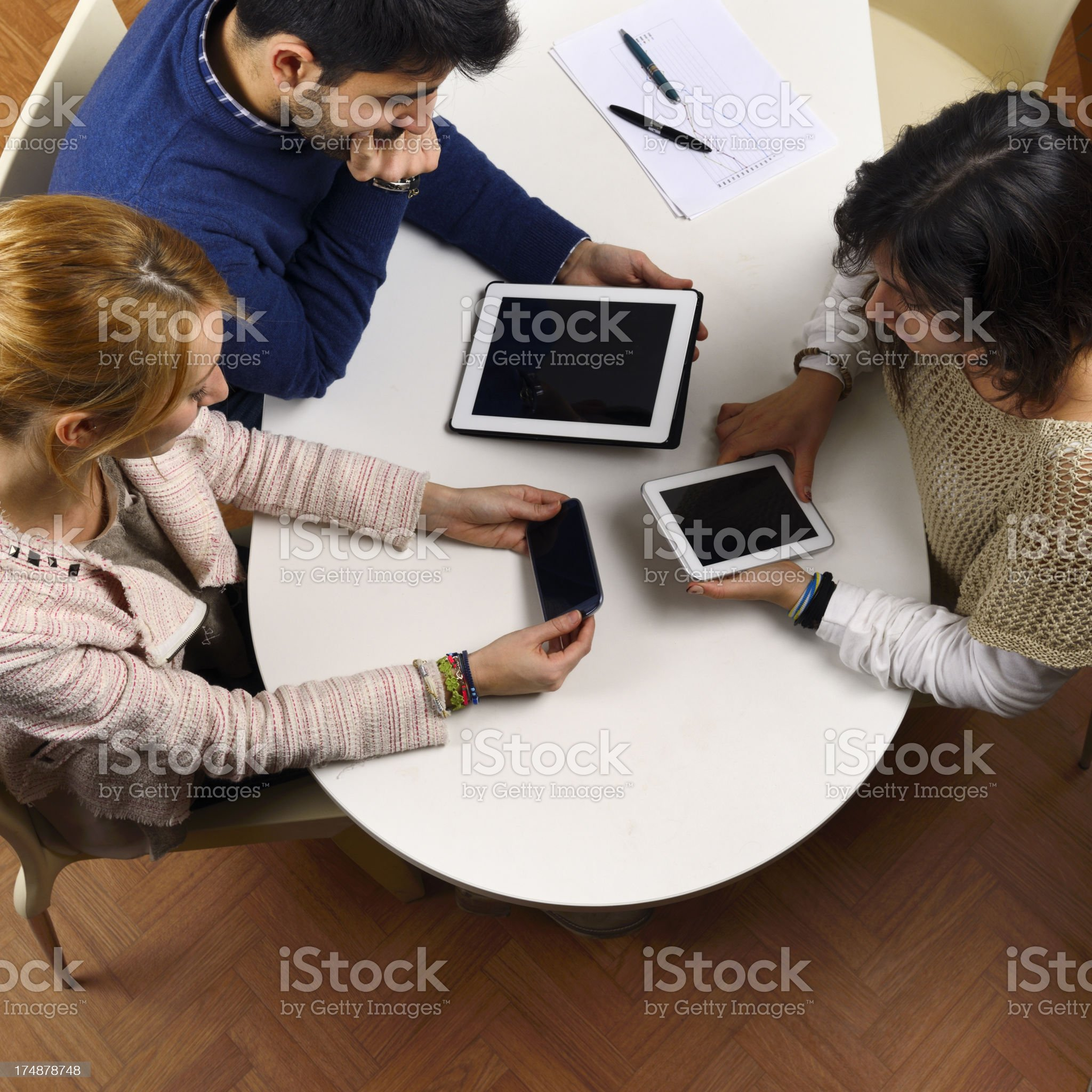 Teamwork using tablet and smart phone royalty-free stock photo