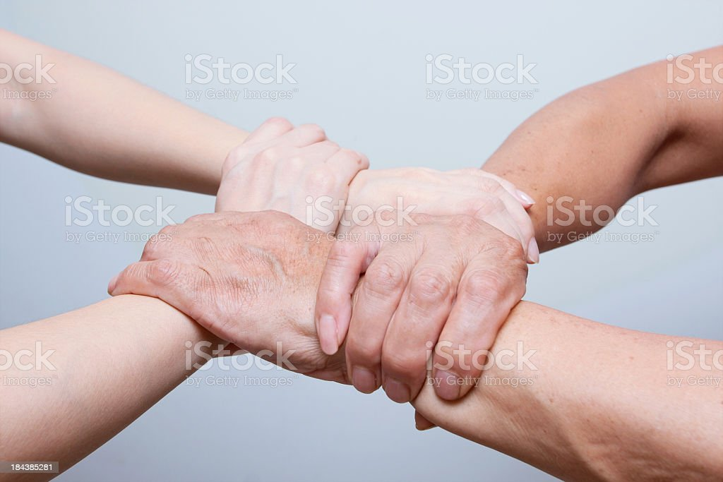 Teamwork with interlocked hands royalty-free stock photo
