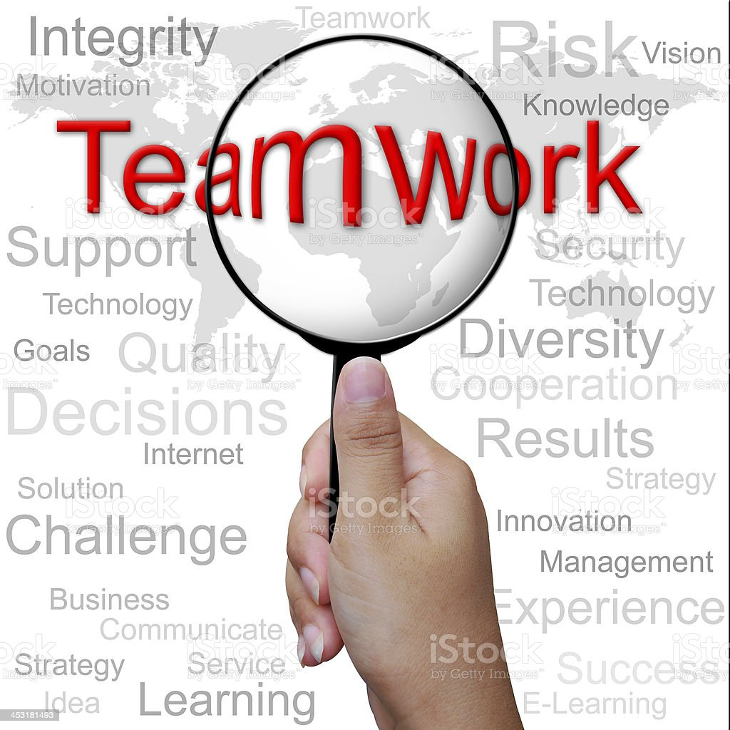 Teamwork, word in Magnifying glass ,business background royalty-free stock photo