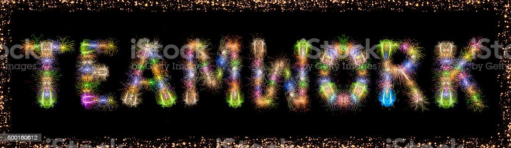 Teamwork word text colorful fireworks with frame - business concept stock photo