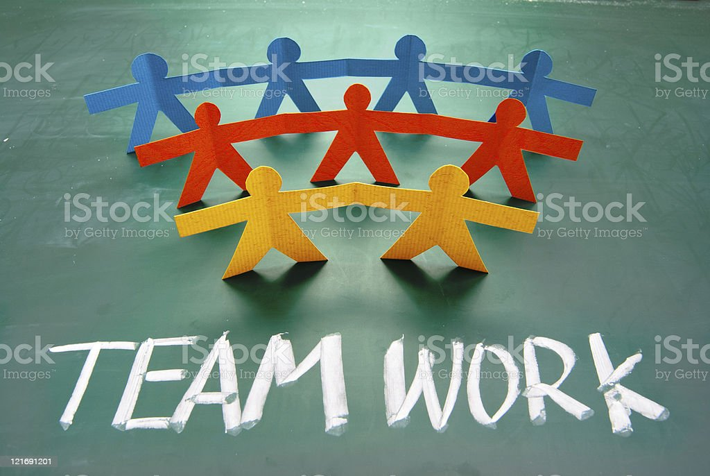 Teamwork words and colorful paper dolls royalty-free stock vector art