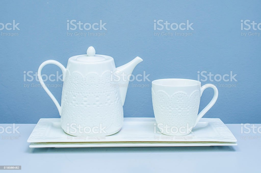 teapot and a cup on a tray stock photo