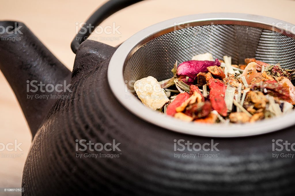 Teapot and dry herbs - Stock Image stock photo