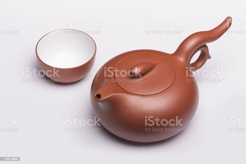 Teapot and empty cup royalty-free stock photo