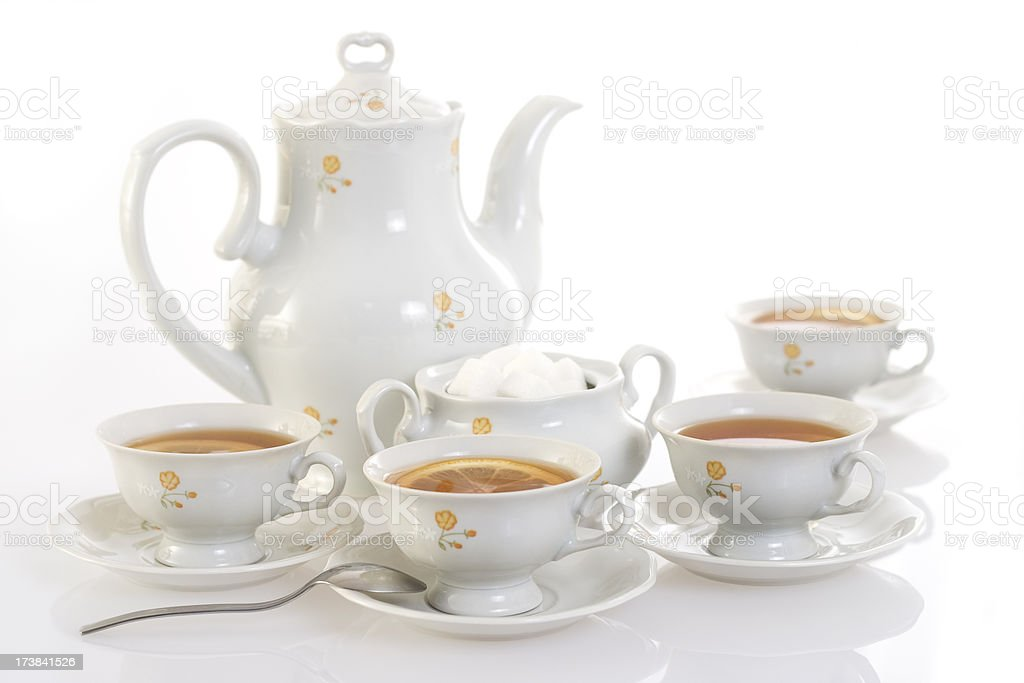 Teapot and four teacups. royalty-free stock photo