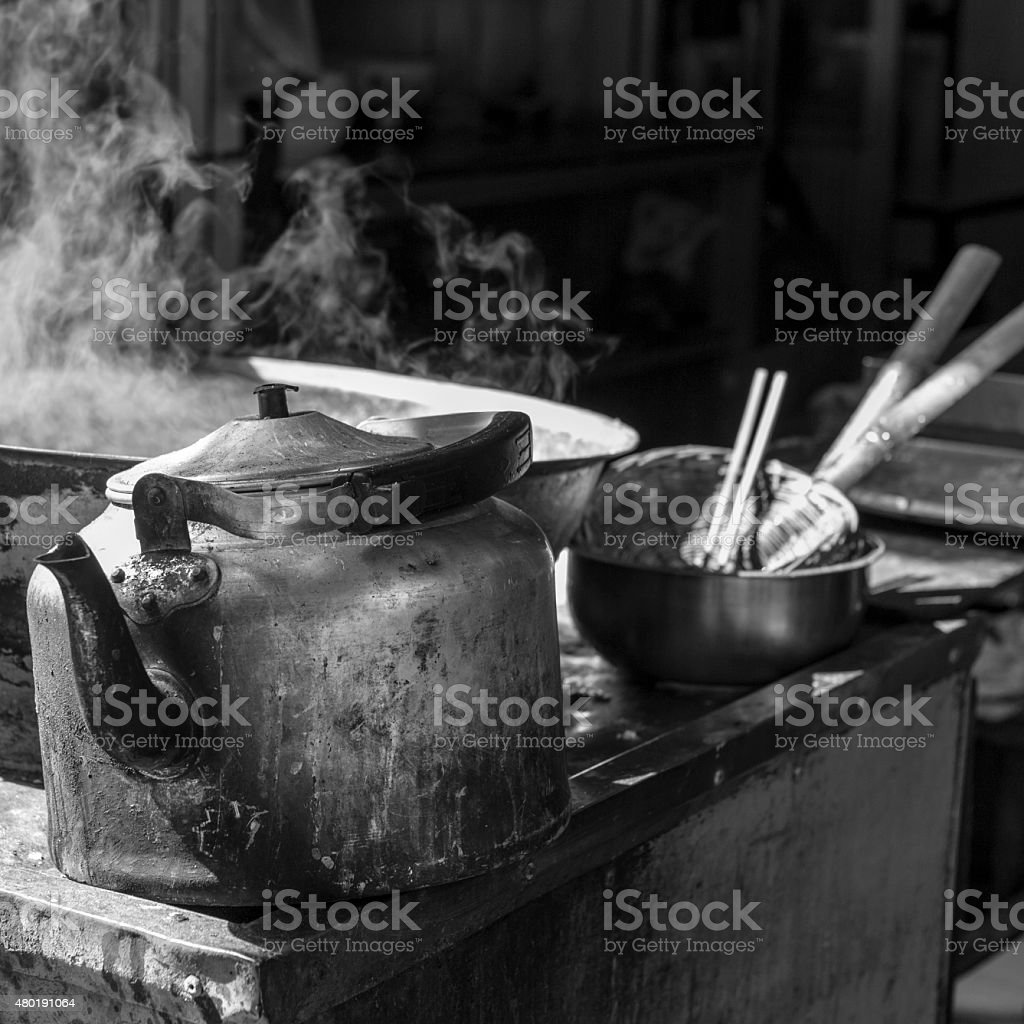 Teapot and steaming pot in the Muslim market, Xian, China stock photo
