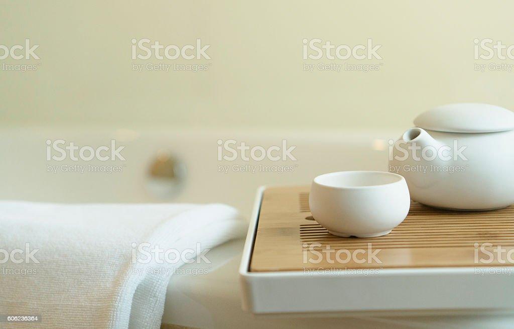 teapot and tea cup on bathtub stock photo