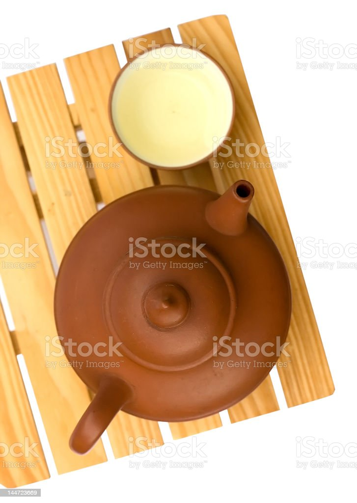 Teapot and teacup on a small wooden table royalty-free stock photo
