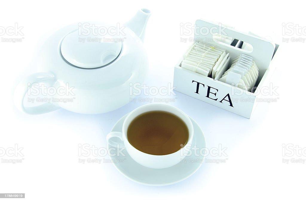 Théière et Tasse à thé avec un ensemble de sacs de thé photo libre de droits