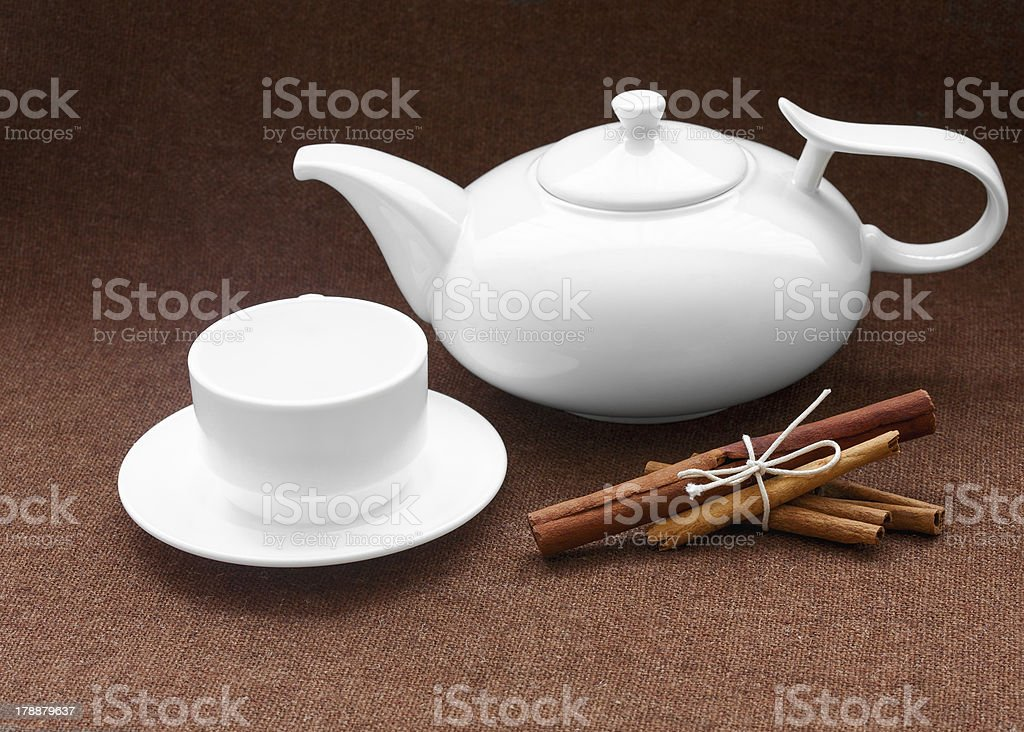 teapot, cup and cinnamon on sacking royalty-free stock photo