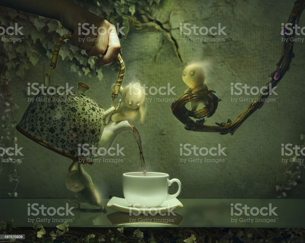 Teapot poring hot tea in a tea cup with ghosts royalty-free stock photo