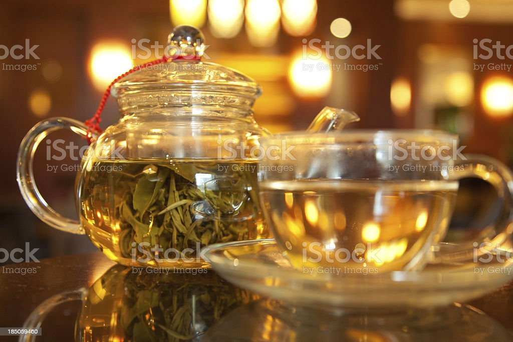 Teapot with green tea royalty-free stock photo