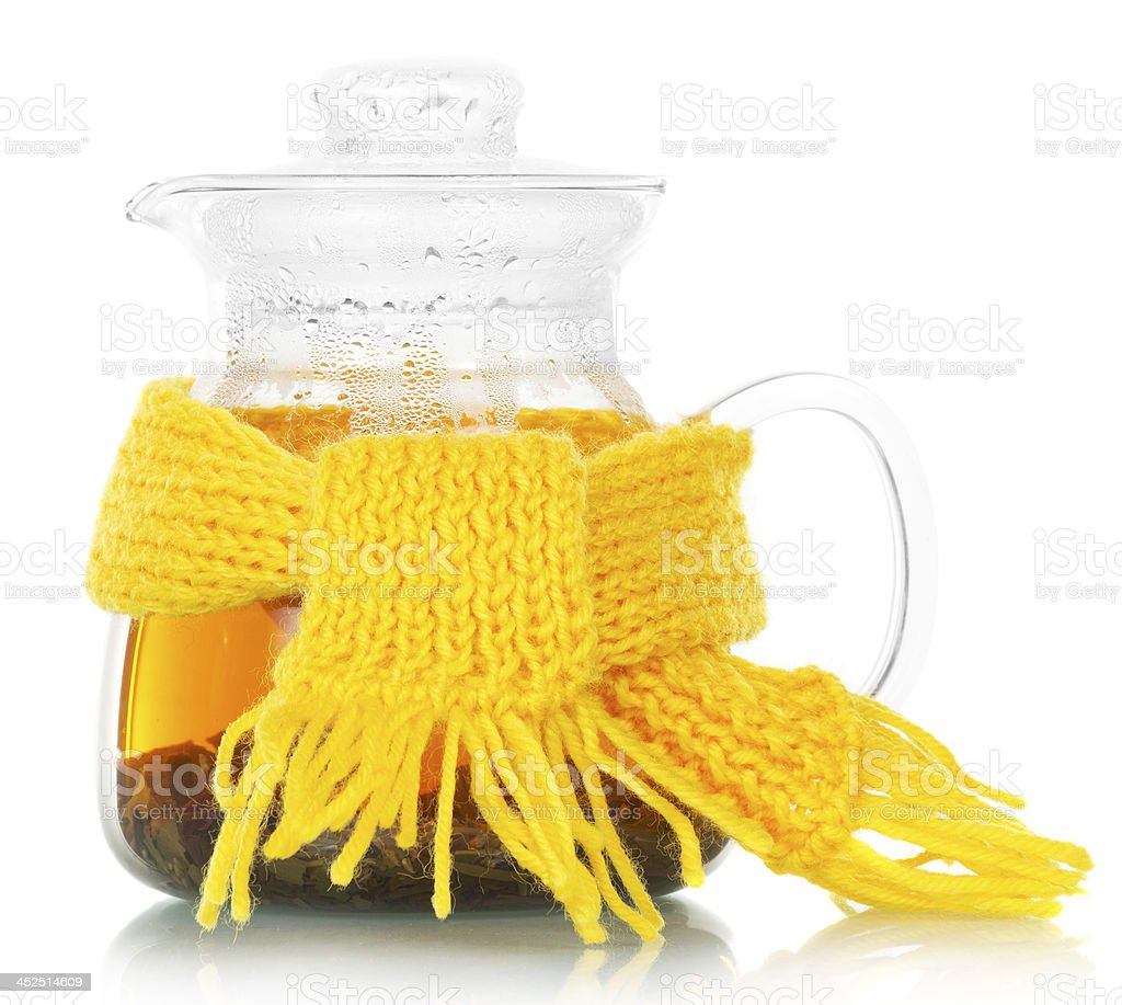 Teapot with tea tied yellow scarf royalty-free stock photo