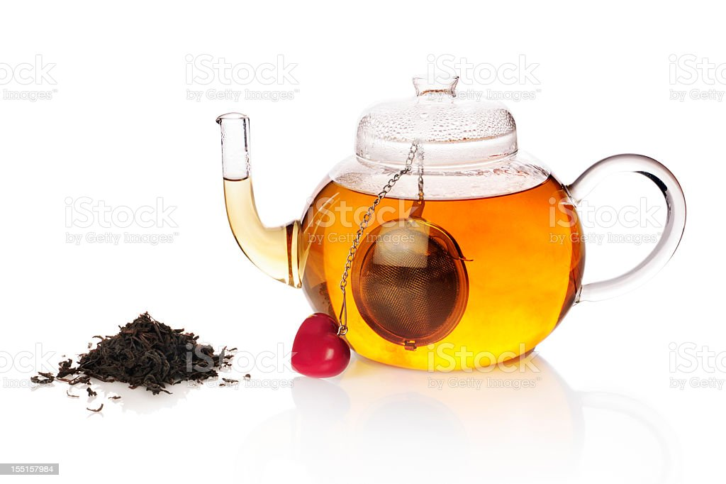 Teapot with teaball and black tea royalty-free stock photo