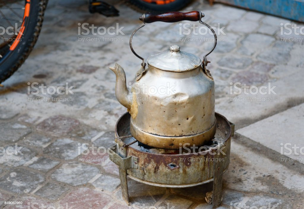 Teapot wtith burner for fire in medina of Essaouira. Morocco stock photo