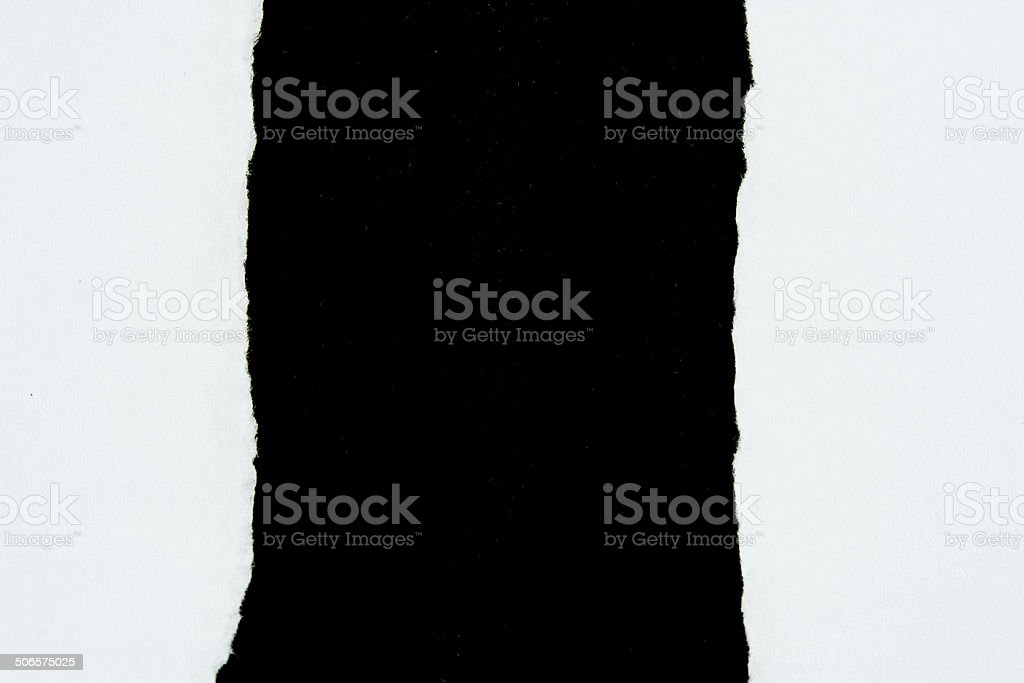 tear white paper pieces of paper on black royalty-free stock photo