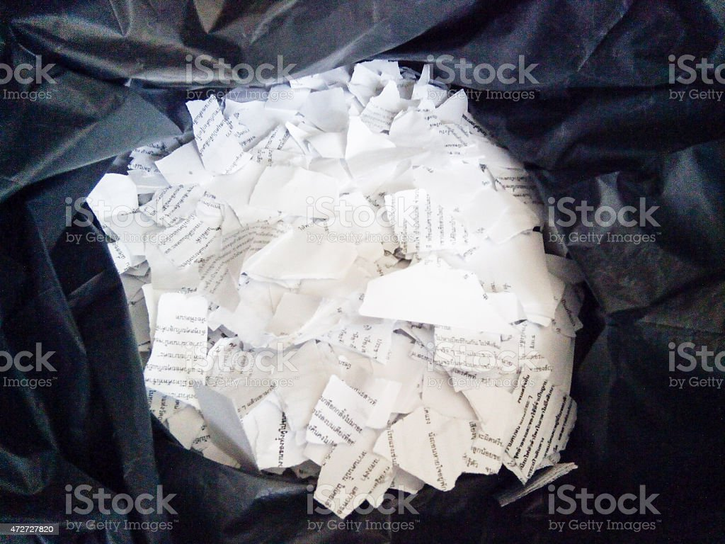 Teared papers in garbage bag stock photo