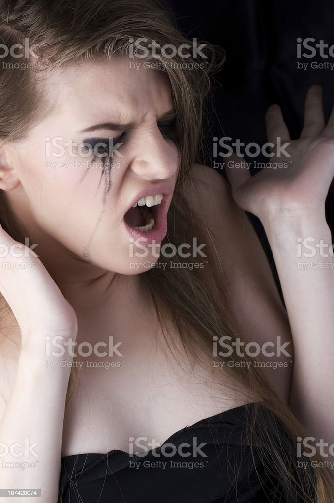 tearful woman screaming royalty-free stock photo