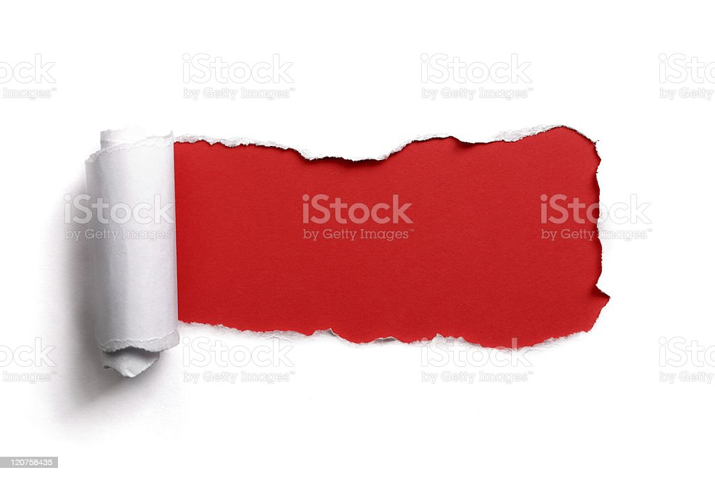 Tearing a paper frame hole over red background stock photo