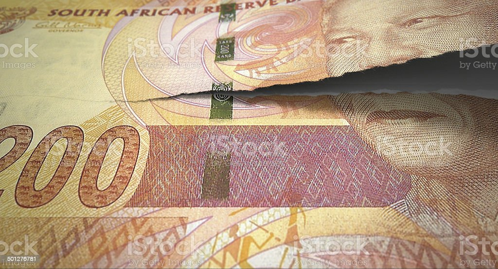 Tearing South African Rand stock photo