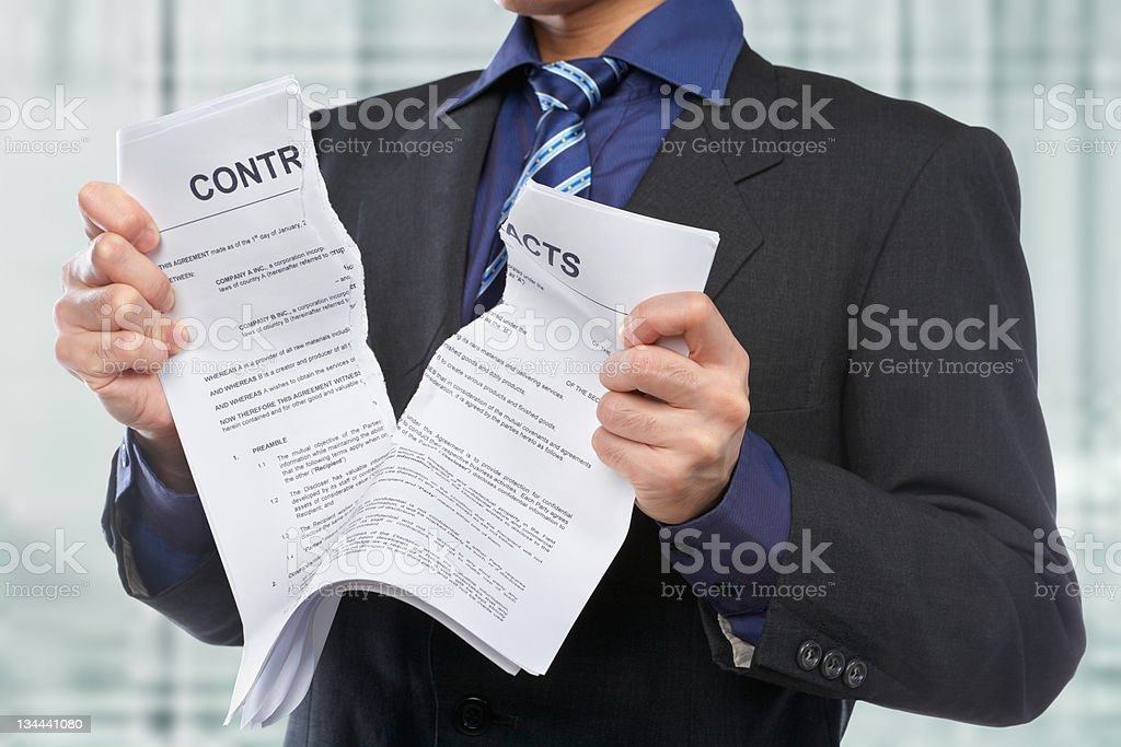 Tearing the contracts stock photo
