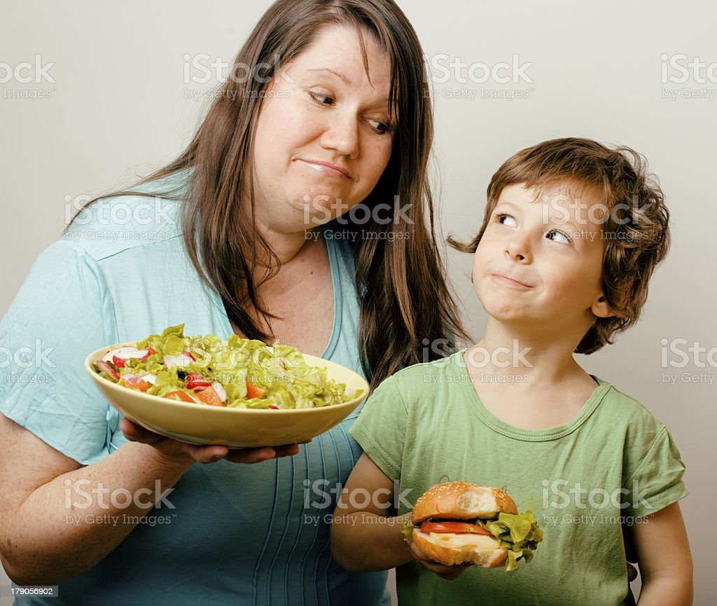 teasing fat woman with hamburger royalty-free stock photo