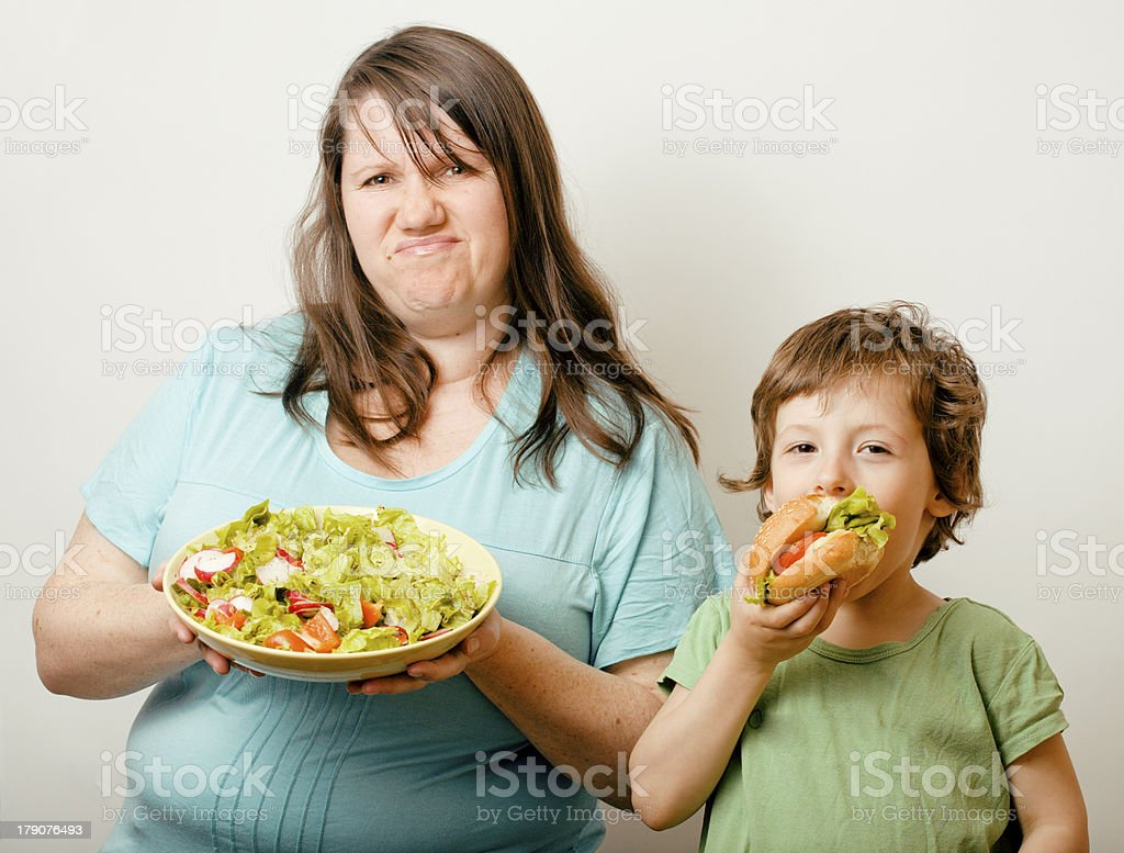 teasing fat woman with hamburger royalty-free stock photo